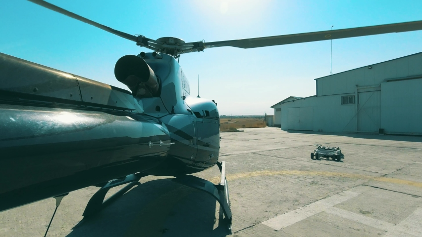 Takeoff of the helicopter from the helicopter base. View from the tail of the helicopter in 4K