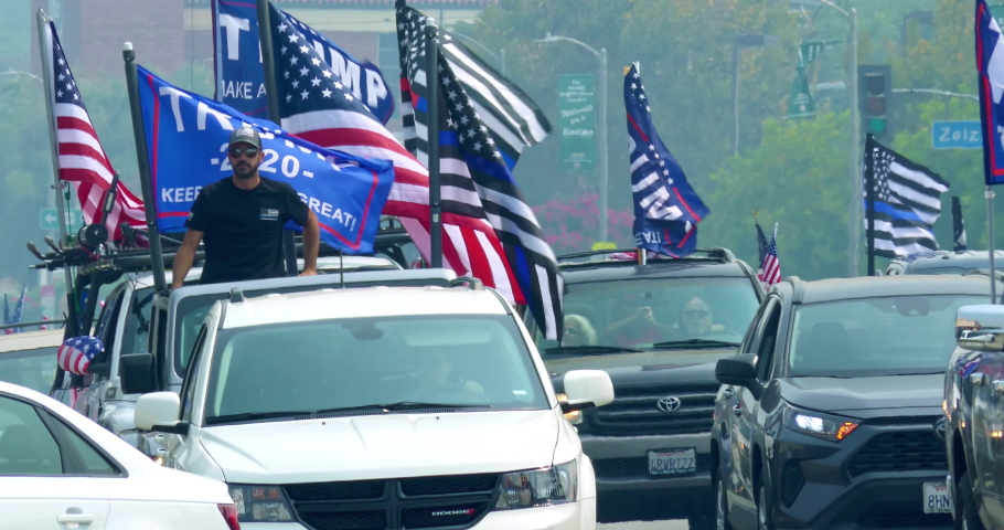 LOS ANGELES, CALIFORNIA, USA - SEPTEMBER 13, 2020: President Donald Trump supporters in cars with American and Israel flag driving in Los Angeles, California, 4K