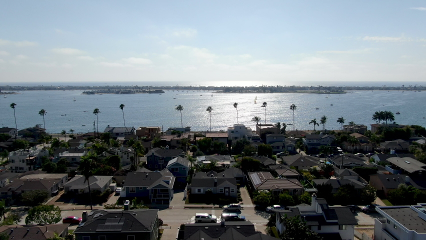 Aerial view of Mission Bay and beaches in San Diego, California. USA. Community built on a sandbar with villas and recreational Mission Bay Park. Californian beach-lifestyle. Royalty-Free Stock Footage #1058983388