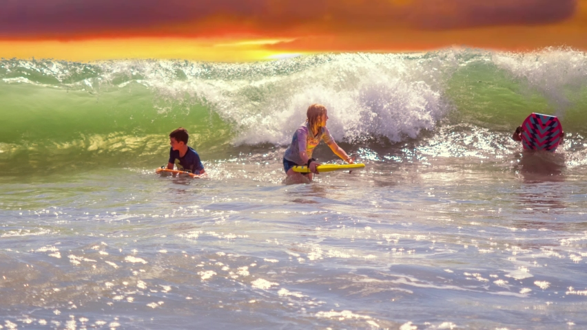 Children Riding Waves on Bodyboards at Myrtle Beach South Carolina. High quality 4k footage