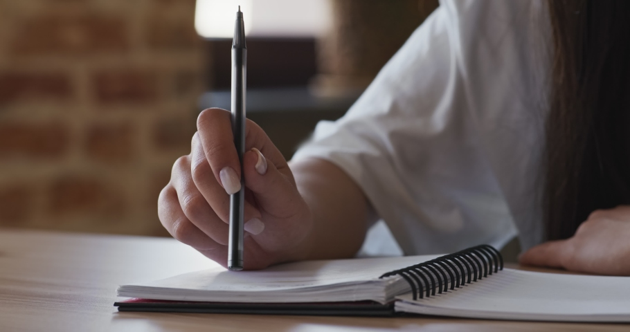 Lack of inspiration. Woman knocking on notebook with pen, thinking process | Shutterstock HD Video #1058992475