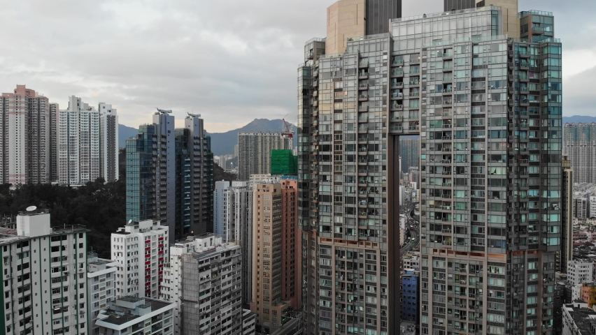 Aerial shot of Kowloon buildings. High risers, skyscrapers. Drone view Hong Kong
