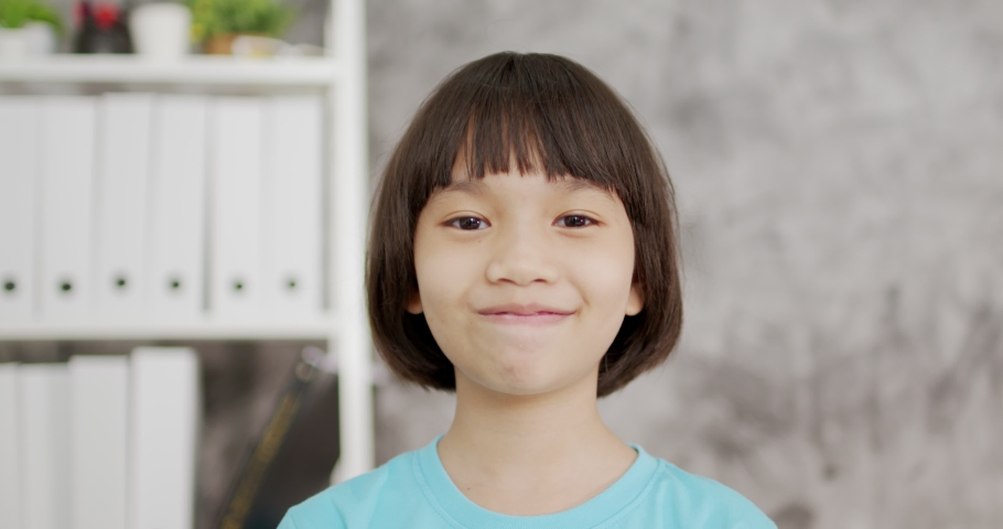 Thai Asian kid girl wave and smiled to camera  | Shutterstock HD Video #1059017801