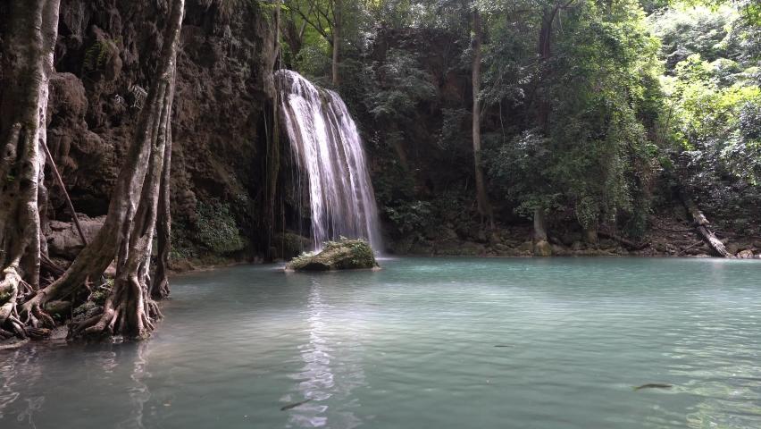 Beautiful waterfall with emerald pond and green forest at Erawan waterfall national park, Kanchanaburi, Thailand.