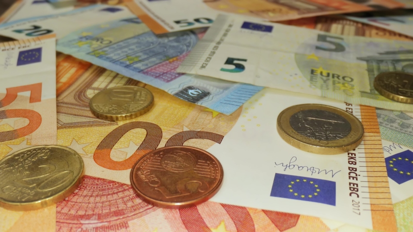 Pile of Different Euro banknotes and coins, macro shot, sliding camera motion Royalty-Free Stock Footage #1059022268