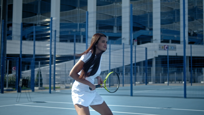 Portrait of female tennis player with racquet at the tennis court, brunette latin american woman, professional player. | Shutterstock HD Video #1059023663