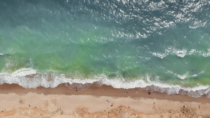 Greenish sea water pollution problem aerial top view of people on the beach at Black Sea Ukraine drone shot | Shutterstock HD Video #1059030371