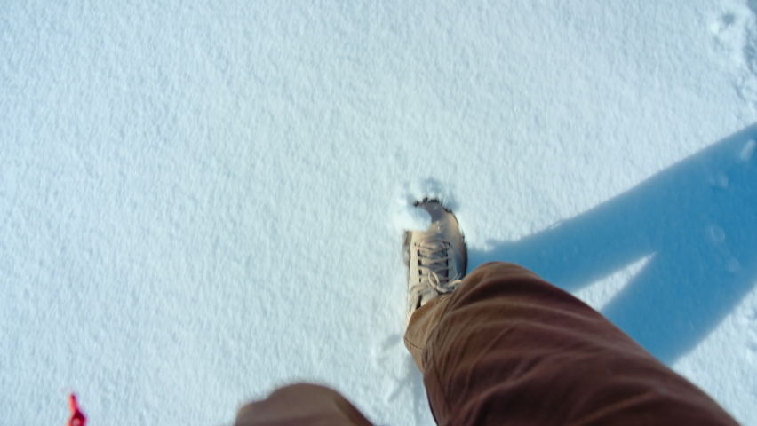 Hiking shoes POV walk on snow on winter hike, explorer boots leave footprints on fresh snow. Walking or hiking during winter season in mountains or forest. Winter outdoor activities Royalty-Free Stock Footage #1059035822
