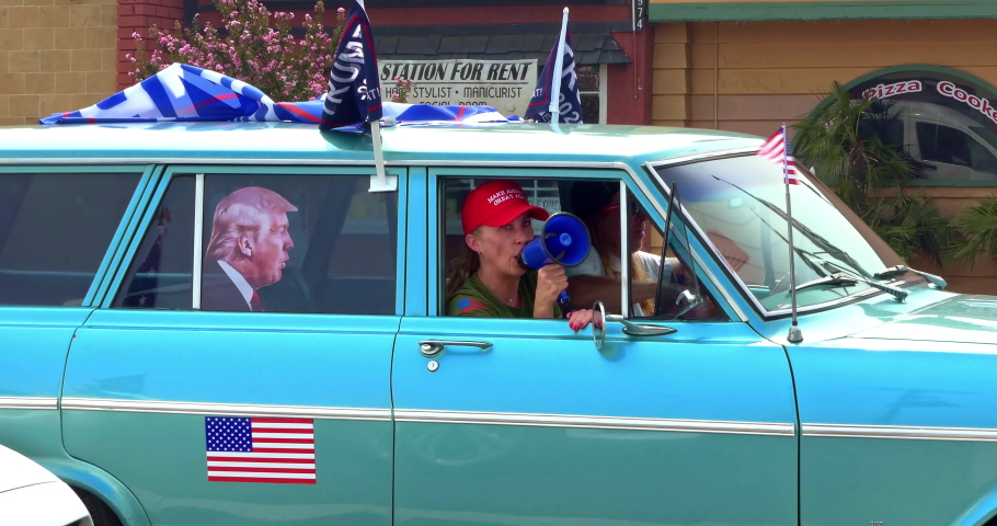 LOS ANGELES, CALIFORNIA, USA - SEPTEMBER 13, 2020: President Donald Trump supporters in cars with megaphone bullhorn at the rally driving in Los Angeles, California, 4K