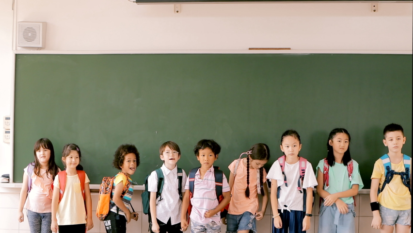 Group of diverse young students standing together in classroom Royalty-Free Stock Footage #1059062228