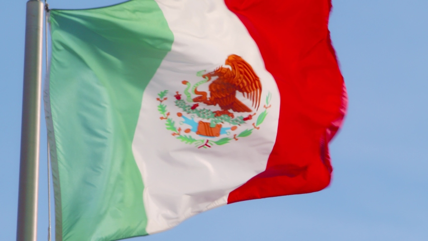 A backlit Mexican flag blowing in the wind. | Shutterstock HD Video #1059071594