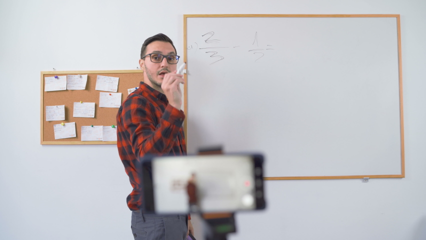 maths teacher teaching remotely online  Royalty-Free Stock Footage #1059075767