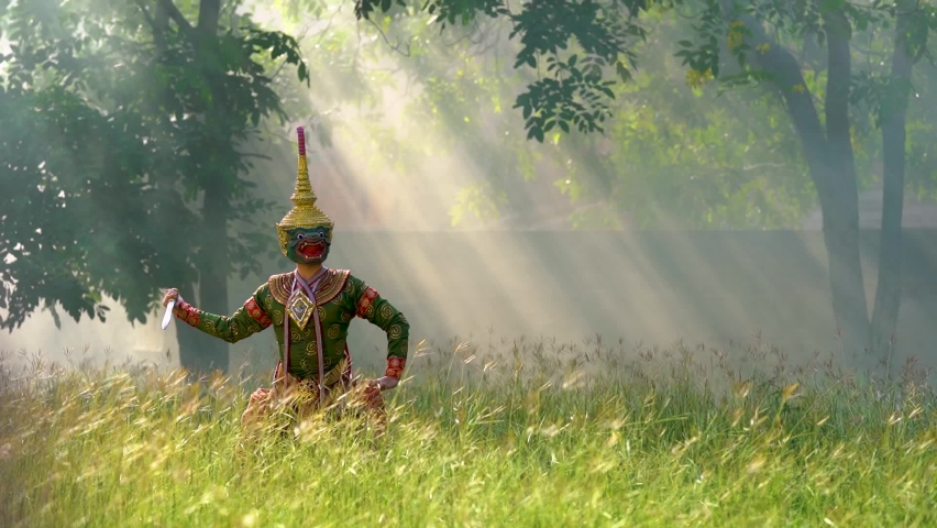 Thailand culture khon performance arts acting entertainment dance traditional costume. Asia acting dancing pantomime show.Actor of green monkey ong kot is performing Ramayana in grass with sun light. | Shutterstock HD Video #1059078539