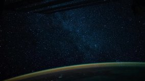 4K timelapse of earth seen from space featuring earth glow and stars of milky way. Image courtesy of NASA.