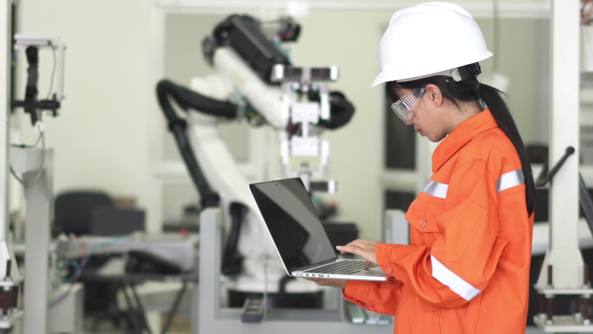 .Young woman examining robotic parts in laboratory. Royalty-Free Stock Footage #1059089990