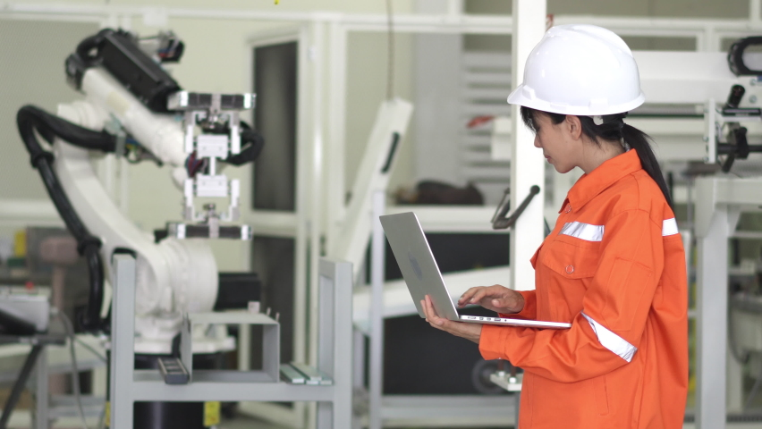 Young woman examining robotic parts in laboratory. Royalty-Free Stock Footage #1059089993
