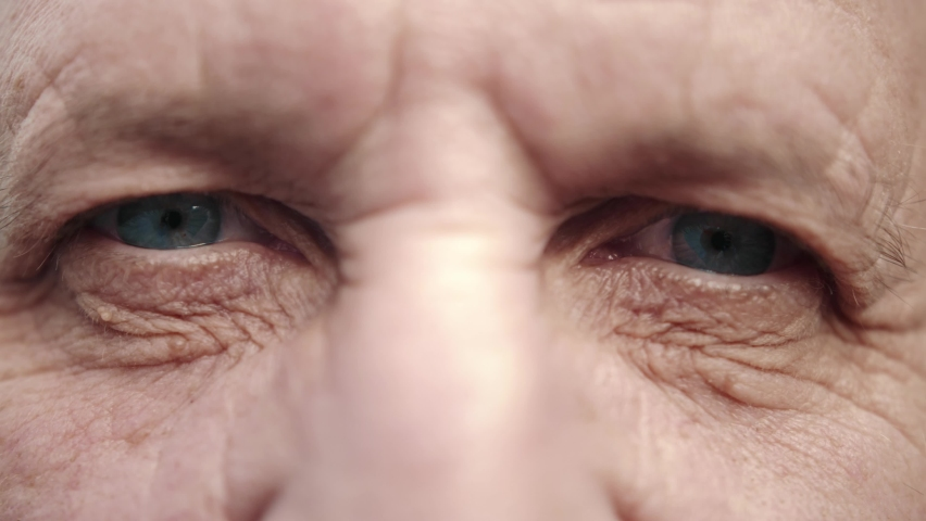 Face and eyes of mature person. Close up of large wrinkles on the face of senior male. Portrait of attractive elderly man. Doctor man face.