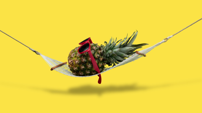 Pineapple jumping and relaxing with sunglasses on hammock. Stop motion animation with alpha channel. | Shutterstock HD Video #1059127055