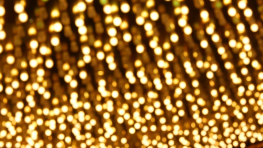 Defocused old fasioned electric lamps glowing at night. Abstract close up of blurred retro casino decoration shimmering, Las Vegas USA. Illuminated vintage style bulbs glittering on Freemont street. | Shutterstock HD Video #1059141050