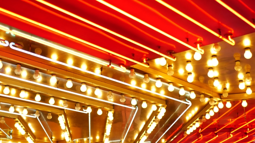 Old fasioned electric lamps blinking and glowing at night. Abstract close up of retro casino decoration shimmering in Las Vegas, USA. Illuminated vintage style bulbs glittering on Freemont street. | Shutterstock HD Video #1059141164