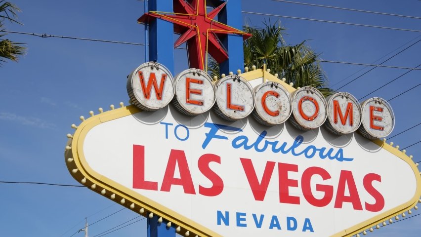 Welcome to fabulous Las Vegas retro neon sign in gambling tourist resort, USA. Iconic vintage banner as symbol of casino, games of chance, money playing and hazard betting. Lettering on signboard. | Shutterstock HD Video #1059141173