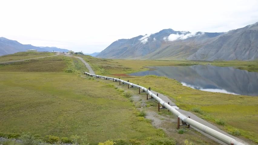 Crude Oil & Petroleum Pipeline in Alaska with Scenic Mountain Backdrop - Aerial Drone