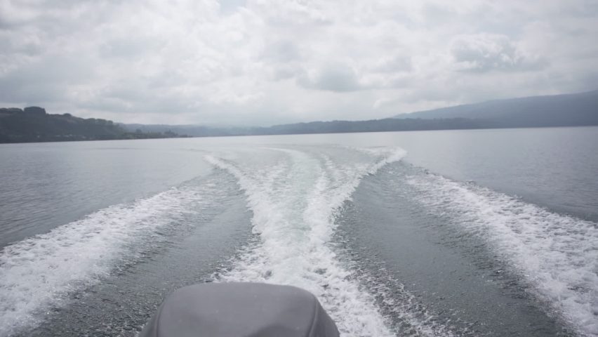 Slomo POV shot of waves behind motorboat on cloudy day in New Zealand | Shutterstock HD Video #1059150044