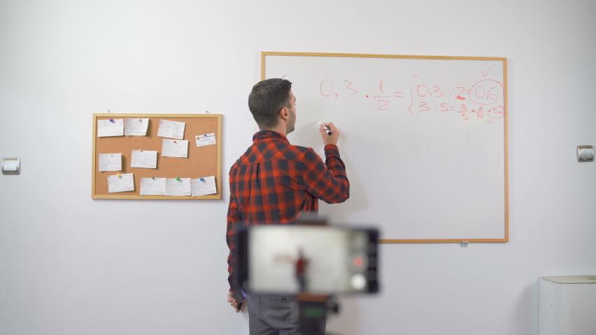 European young Teacher online Live Math Teaching talking on Camera | Shutterstock HD Video #1059158558