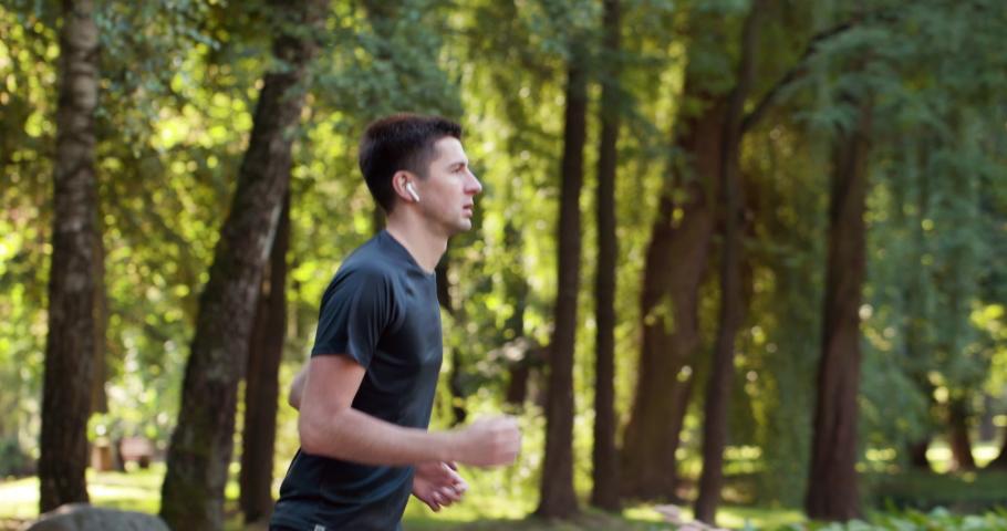 Sportsman Jog Cardio Workout. Runner Fitness Hard Training Before Running Marathon Competition. Running Man Fitness Exercising. Athlete Jogging In Park Preparing Triathlon. Sport Healthy Lifestyle. Royalty-Free Stock Footage #1059158936