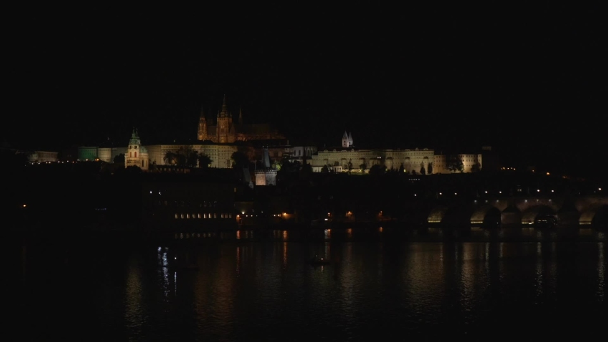 Level of the Vltava river and the kraluv bridge and prague castle and the church of st. welcome at night | Shutterstock HD Video #1059165482