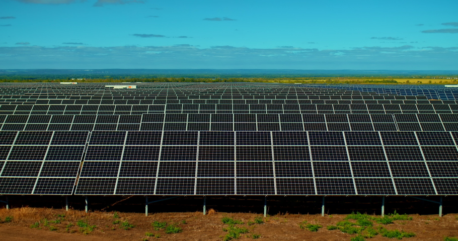 Solar panels stand in a row, state of the art solar energy conversion plants. Innovative technologies, solar cells. 4k, ProRes | Shutterstock HD Video #1059166001