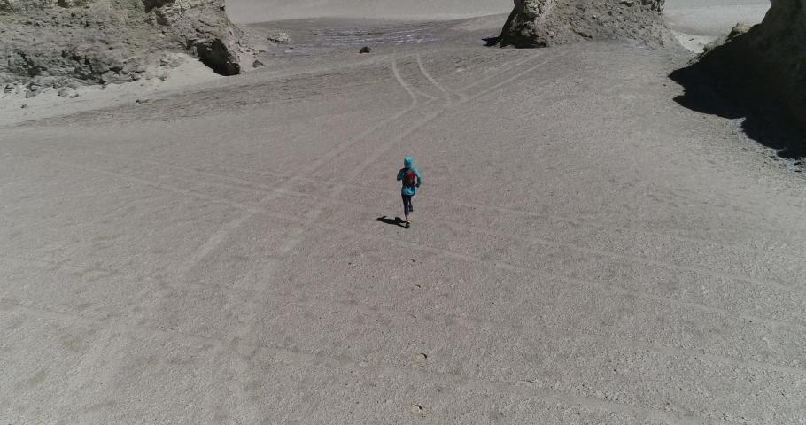 Fitness woman ultra marathon runner cross country running up a slope on sand desert  | Shutterstock HD Video #1059168146