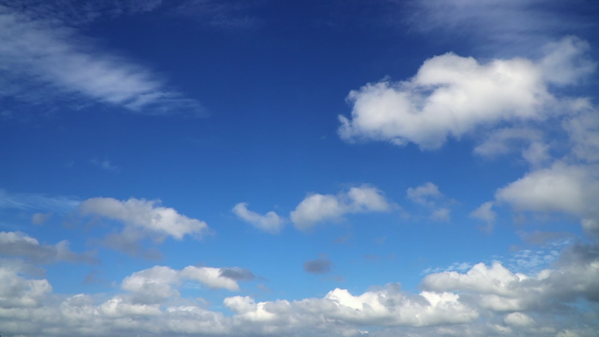 Storm clouds move, Puffy fluffy white clouds blue sky time lapse motion background. Bright blue sky, cloudscape cloudy heaven. Summer natural beautiful colours. Ultra HD Cloudy stormy dramatic. | Shutterstock HD Video #1059168356