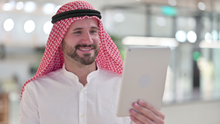 Arab Businessman doing Video Chat on Tablet