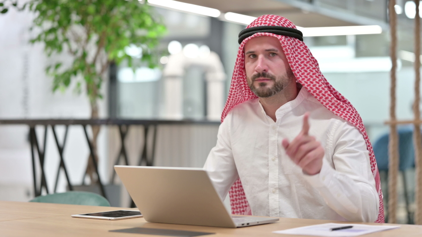 Arab Businessman with Laptop saying No with Finger Sign   Shutterstock HD Video #1059168581