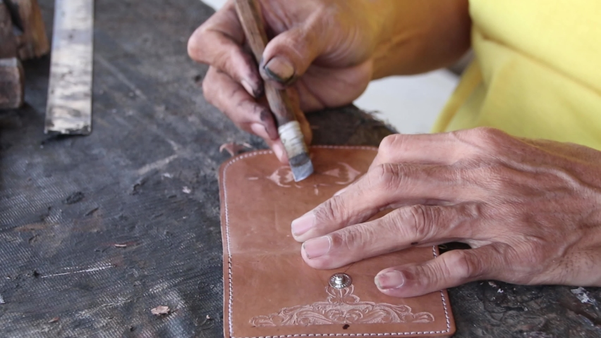 Blurry Selective focus clip, craftsman when carving leather for decoration, manually in his garage | Shutterstock HD Video #1059174806