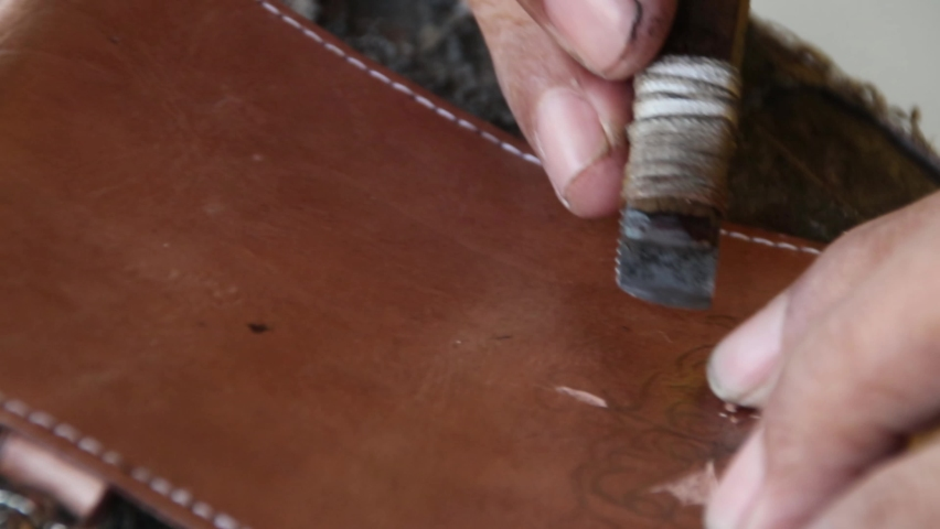 Blurry Selective focus clip, craftsman when carving leather for decoration, manually in his garage | Shutterstock HD Video #1059174815