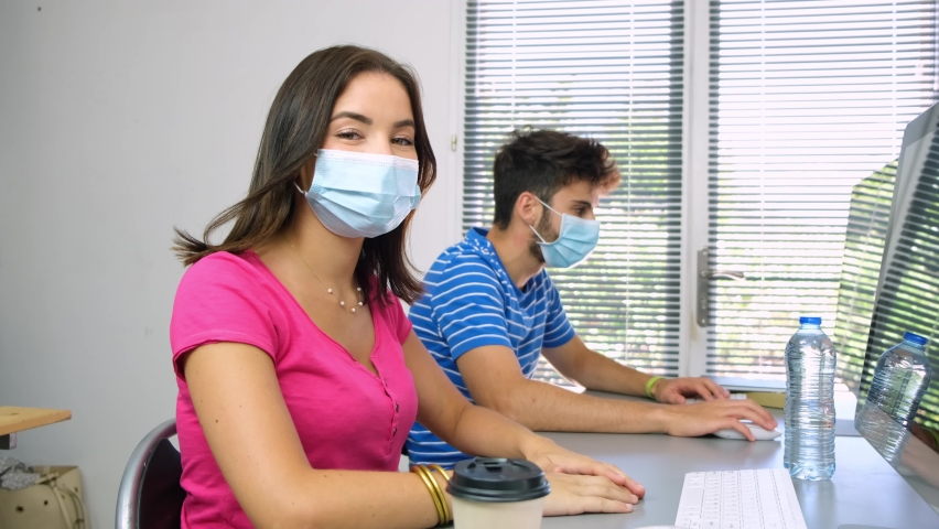 Students in high school classroom wearing protection mask against pandemic virus  | Shutterstock HD Video #1059175916