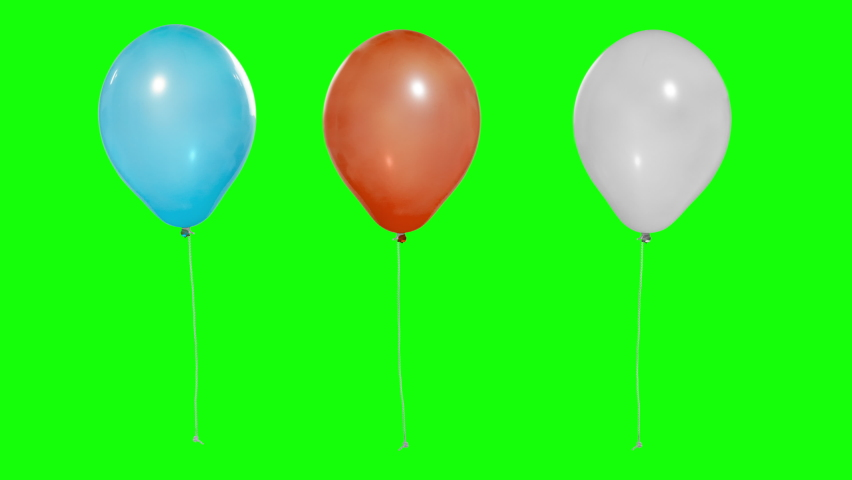 Three multi-colored balloons in the air. Flying balloons. Multicolored balloons. For selection by mask. Helium balloon with rope. Chroma key. Green screen. Ultra HD - 4K (2160p) | Shutterstock HD Video #1059179114