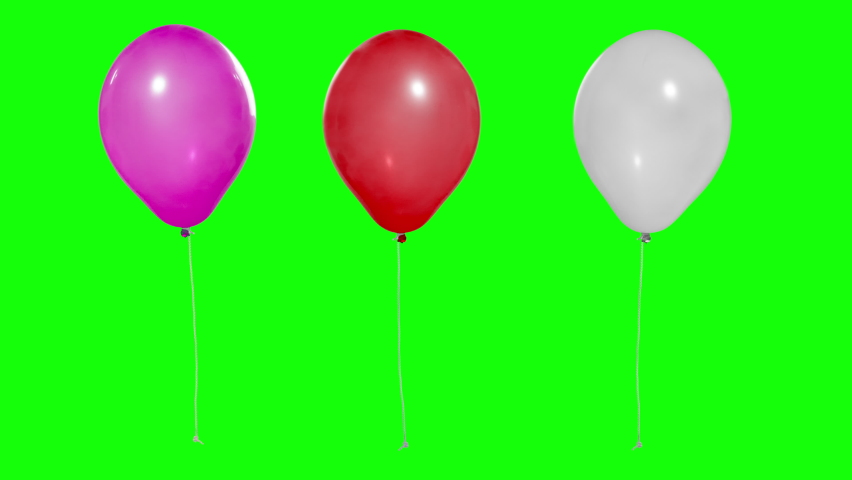 Three colorful balloons flying in the air. Flying balloons. Multicolored balloons. For selection by mask. Helium balloon with rope. Chroma key. Keying. Green screen. Ultra HD - 4K (2160p) | Shutterstock HD Video #1059180896