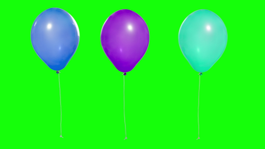 Three multi-colored balloons in the air. Flying balloons. Multicolored balloons. For selection by mask. Helium balloon with rope. Chroma key. Keying. Green screen. Ultra HD - 4K (2160p) | Shutterstock HD Video #1059180899