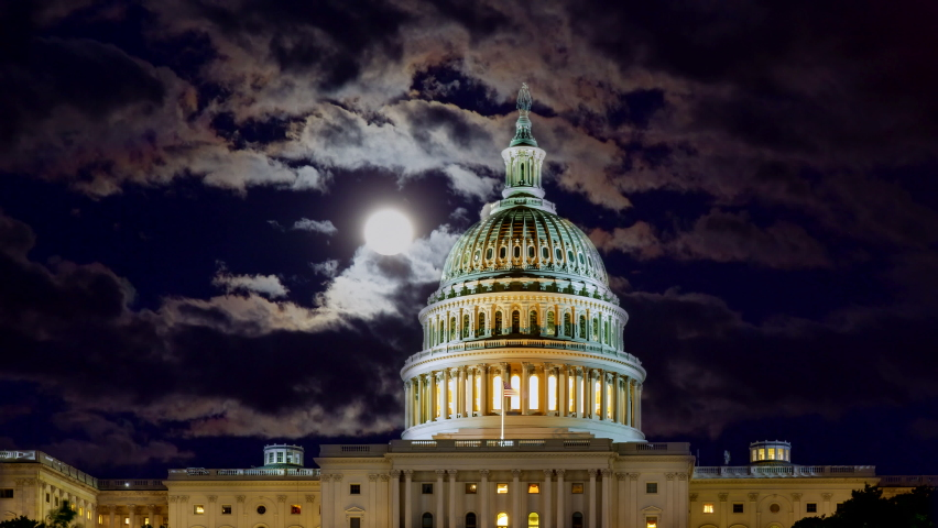 Full moon shining on the night sky with U.S. Capitol Building Dome at Washington, DC, USA | Shutterstock HD Video #1059186338