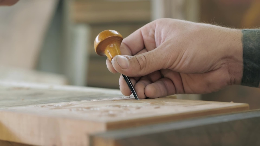 Close-up. carpenter makes wood carving with a chisel and mallet. Carpentry, craftsmanship, design, manufacturing concept. | Shutterstock HD Video #1059186944