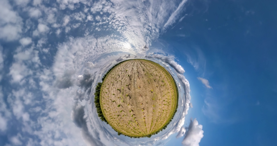 Little planet revolves among blue sky and white clouds. Little planet transformation with curvature of space. loop rotate. | Shutterstock HD Video #1059189893