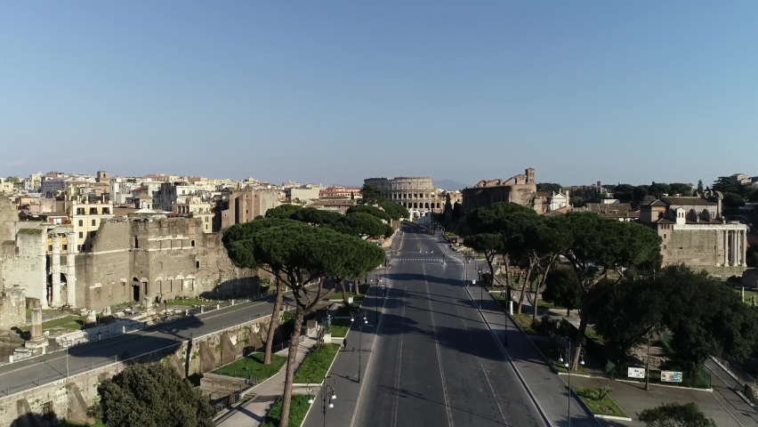 Drone view of the IMPERIAL FORUMS and the COLOSSEUM in Rome Royalty-Free Stock Footage #1059192482