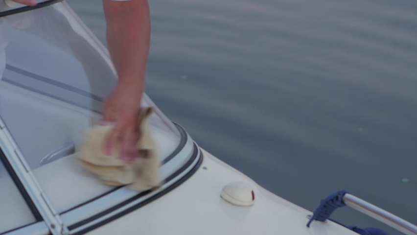 Wipe the boat unrecognizable man cleaning a yacht slow motion closeup | Shutterstock HD Video #1059193529