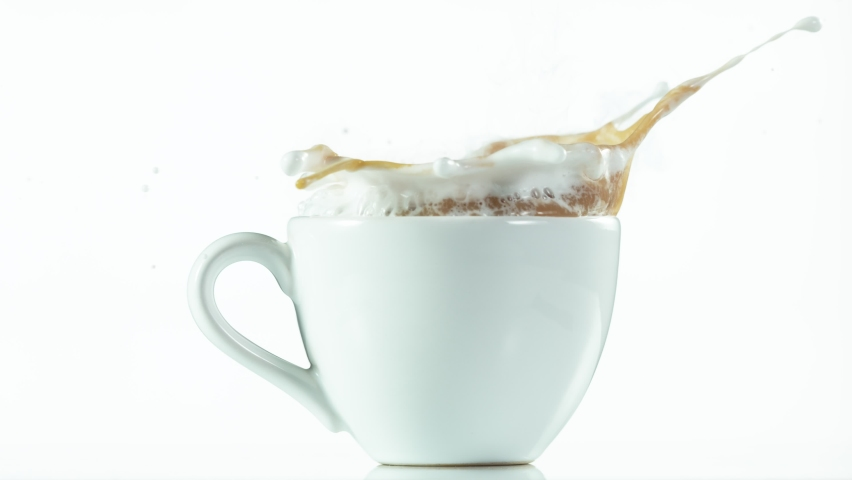 Super slow motion of falling sugar cubes into coffee cup, on white background. Filmed on very high speed camera. 1000fps.   Shutterstock HD Video #1059193622