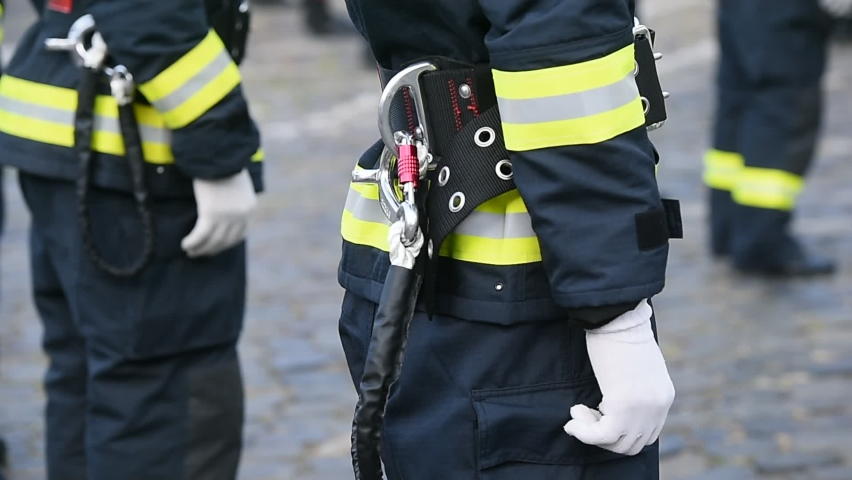 Fire fighters uniform detail with carabiner and harness during ceremony  | Shutterstock HD Video #1059196400