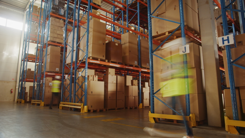 Time-Lapse: Retail Delivery Warehouse full of Shelves with Goods in Cardboard Boxes, Workers Sort Packages, Move Inventory with Pallet Trucks and Forklifts. Product Distribution Logistics Center