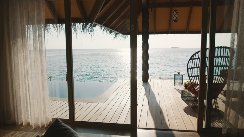 Tropical resort room with infinity pool. Stylish bungalow overwater with private swimming pool in luxury resort.  Royalty-Free Stock Footage #1059202247